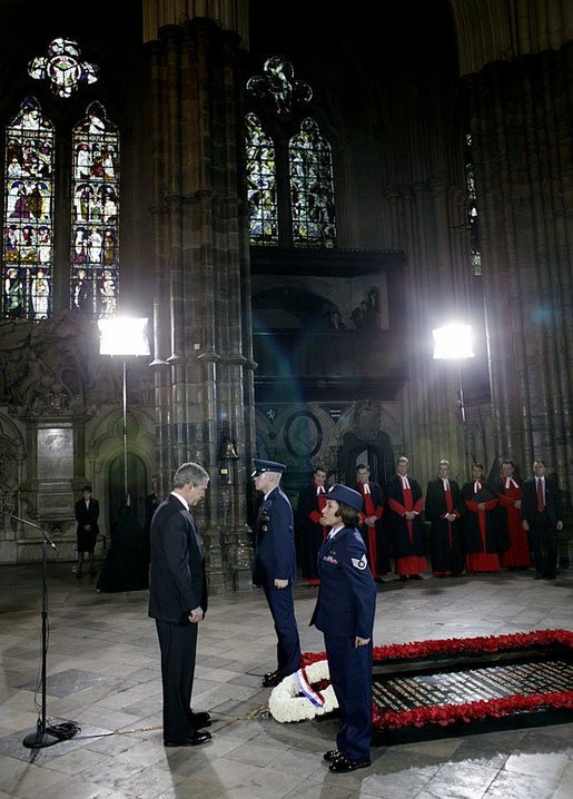 President George W. Bush bows his head in silence as a wreath is laid at the Tomb of the Unknown Warrior at Westminster Abbey in London Thursday, Nov. 20, 2003. White House photo by Eric Draper.