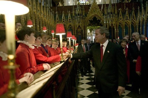 After listening to the Westminster Abbey Choir perform, President George W. Bush greets one of the younger choir members during his and Mrs. Bush's tour of the abbey Thursday, Nov. 20, 2003. White House photo by Eric Draper.