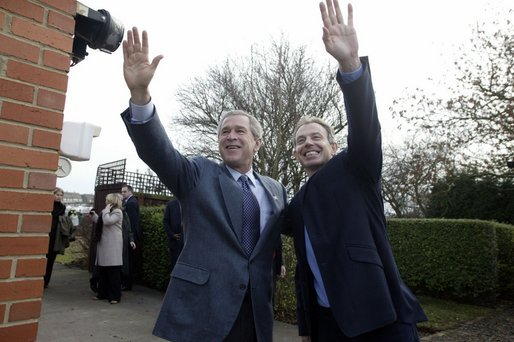 President George W. Bush and Prime Minister Tony Blair wave to onlookers during the President's visit to the Blair's home. White House photo by Eric Draper.