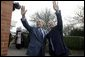 President George W. Bush and Prime Minister Tony Blair wave to onlookers during the President�s visit to the Blair�s home.  White House photo by Eric Draper