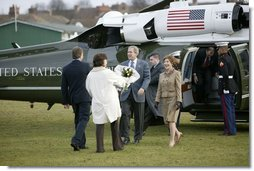 President George W. Bush and Mrs. Laura Bush arrive at Prime Minister Tony Blair and Mrs. Blair's home, Myrobella House, Trimdon Station.  White House photo by Eric Draper