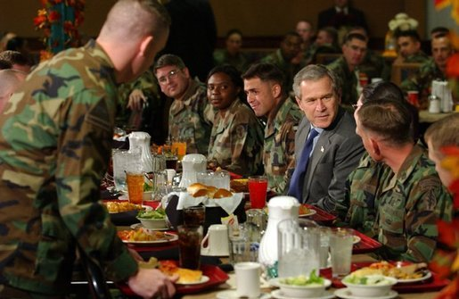 President George W. Bush enjoys lunch with U.S. soldiers at Fort Carson, Colorado Nov. 24, 2003. White House photo by Tina Hager