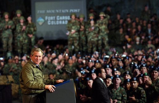 President George W. Bush delivers remarks to U.S. soldiers and families at Fort Carson, Colorado Nov. 24, 2003 White House photo by Tina Hager