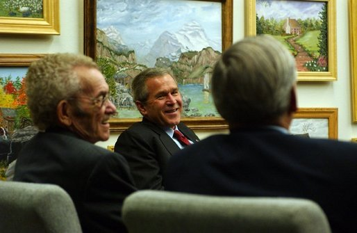 President George W. Bush participates in a conversation with seniors at Los Olivos Senior Center Association in Phoenix, Arizona. Tuesday, Nov. 25, 2003. White House photo by Tina Hager.