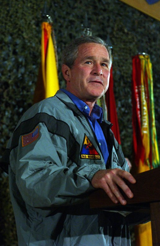 President George W. Bush delivers remarks to troops on Thanksgiving Day in Baghdad, Iraq. Thursday, November 27, 2003. White House photo by Tina Hager.