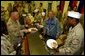 President George W. Bush meets with troops and serves Thanksgiving Dinner at the Bob Hope Dining Facility, Baghdad International Airport, Iraq,, Thursday, November 27, 2003. White House photo by Tina Hager.