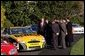 "President George W. Bush jokes with NASCAR racers after looking over the stock cars parked on the South Lawn Tuesday, Dec. 2, 2003. ""I've hosted champions from many sports here at the White House, this is the first time, however, we ever parked stock cars in the South Lawn,"" President Bush said. White House photo by Tina Hager."