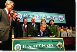 President George W. Bush signs the Healthy Forests Restoration Act of 2003 at the Department of Agriculture Wednesday, December 3, 2003.  White House photo by Tina Hager