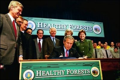 President George W. Bush signs the Healthy Forests Restoration Act of 2003 at the Department of Agriculture Wednesday, December 3, 2003. White House photo by Tina Hager. White House photo by Tina Hager