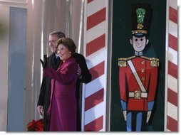 President George W. Bush and Mrs. Laura Bush arrive at the Pageant of Peace to light the National Christmas Tree at the Ellipse in Washington DC on Thursday December 4, 2003.  White House photo by Paul Morse