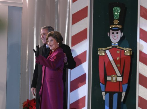 President George W. Bush and Mrs. Laura Bush arrive at the Pageant of Peace to light the National Christmas Tree at the Ellipse in Washington DC on Thursday December 4, 2003. White House photo by Paul Morse.