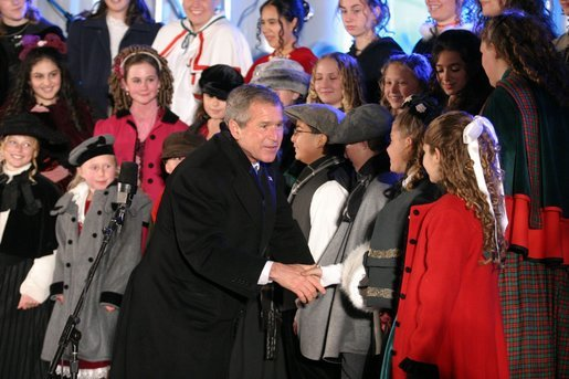 President George W. Bush greets the Voena Children's Choir at the Pageant of Peace after lighting the National Christmas Tree at the Ellipse in Washington DC on Thursday December 4, 2003. White House photo by Paul Morse.