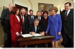 President George W. Bush signs H.R. 2622, the Fair and Accurate Credit Transactions Act of 2003, into law during a ceremony in the Roosevelt Room Thursday, December 4, 2003.  White House photo by Tina Hager