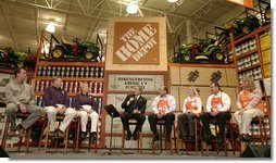 President George W. Bush participates in a conversation on the economy with employees of the Home Depot home improvement stores in Baltimore, Maryland on December 5, 2003.  White House photo by Paul Morse