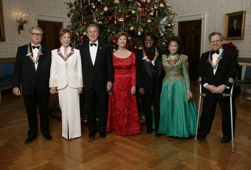 President George W. Bush and Mrs. Bush are photographed with the Kennedy Center Honorees during the White House Reception for the Kennedy Center Honors, Sunday, Dec. 7, 2003. From left are, Director Mike Nichols, Actress Carol Burnett, Musician James Brown, Singer Loretta Lynn and Violinist Itzhak Perlman. White House photo by Eric Draper.