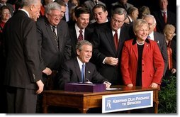 "President George W. Bush signs H. R. 1, the Medicare Prescription Drug, Improvement and Modernization Act of 2003, at Constitution Hall in Washington, D.C., Dec. 8, 2003. ""With this law, we are providing more access to comprehensive exams, disease screenings, and other preventative care, so that seniors across this land can live better and healthier lives,"" said President Bush.  White House photo by Paul Morse"