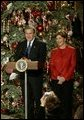 President George W. Bush and Laura Bush host a Christmas reception for children of deployed military personnel at the White House Monday, Dec. 8, 2003. A variety of activities were held for the children, including a performance of selected scenes from The Nutcracker and a visit by Santa Claus. White House photo by Eric Draper