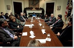 President George W. Bush meets with Iraqi Senior Diplomatic Representative Rend Al-Rahim and members of Iraq's National Symphony Orchestra in the Roosevelt Room Wednesday, Dec. 10, 2003. President Bush and Ms. Al-Rahim attended a performance by the orchestra at the Kennedy Center Dec. 9, 2003.  White House photo by Paul Morse
