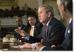 President George W. Bush speaks to reporters at the end of his Cabinet Meeting, Thursday, Dec. 11, 2003.  White House photo by Eric Draper