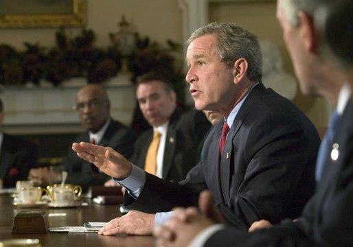 President George W. Bush speaks to reporters at the end of his Cabinet Meeting, Thursday, Dec. 11, 2003. White House photo by Eric Draper.