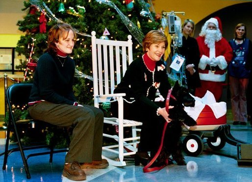 Laura Bush introduces her Scottish Terrier Barney Bush at the Children's National Medical Center during the annual Christmas program and visit to the hospital Friday, Dec. 12, 2003. Mrs. Bush is accompanied by Stephanie Chapman. White House photo by Susan Sterner