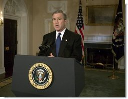 President George W. Bush addresses the nation on the capture of Saddam Hussein from the Cabinet Room, Sunday, Dec. 14, 2003.  White House photo by Eric Draper