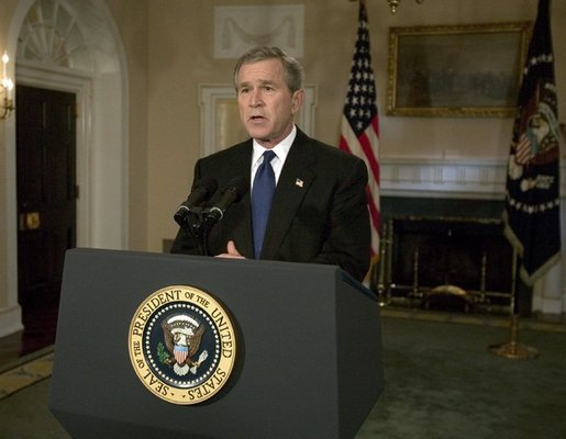President George W. Bush addresses the nation on the capture of Saddam Hussein from the Cabinet Room, Sunday, Dec. 14, 2003. White House photo by Eric Draper.