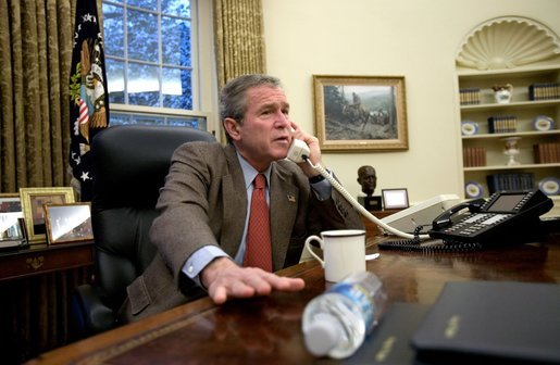 President George W. Bush speaks with British Prime Minister Tony Blair during a phone call in the Oval Office, Sunday morning, Dec. 14, 2003. White House photo by Eric Draper.