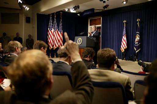 Discussing President George W. Bush takes questions during a press conference in the Dwight D. Eisenhower Executive Office Building Monday, Dec. 15, 2003. White House photo by Paul Morse