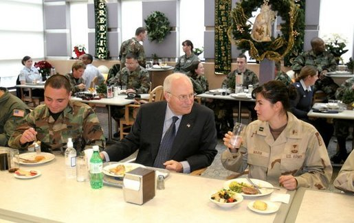 During lunch with troops from McChord Air Force Base and Fort Lewis, Vice President Dick Cheney talks with Capt. Lyn Marm, right, and Senior Airman Jose L. Negron, left, at McChord Air Force Base, Wash., Dec. 22, 2003. Prior to lunch, Vice President Cheney addressed the troops and presented the Bronze Star to Maj. Brian Robinson and The Purple Heart to Spc. Justin L. Anderson and Sgt. Johnie L. Smith. Vice President Cheney presented Air Medals to Capt. Paul Sontein, Capt. Anne R. Lueck, 1st Lt. Andrew D. Oiland, Tech. Sgt. James S. Alexander and Staff Sgt. Eric M. Olsen. White House photo by David Bohrer.