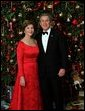 Celebrating the 2003 holiday season, President George W. Bush and Laura Bush pose for a Christmas portrait in front of the White House Christmas Tree. White House photo by Eric Draper