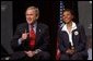 "President George W. Bush discusses the No Child Left Behind Act at Pierre Laclede Elementary School with Principal Yolanda Moss and other faculty members in St. Louis, Mo., Monday, Jan. 5, 2004. ""This school is a school that has performed -- you have to say, brilliantly,"" said President Bush of Lacledes' raising the grade level reading of third grade students from 7 percent in 1999 to 80 percent today. ""That speaks to strong principals, it speaks to really good teachers. It says this school has got teachers that believe in the capability of every child. It says the school has raised standards and is not afraid to measure."" White House photo by Tina Hager"