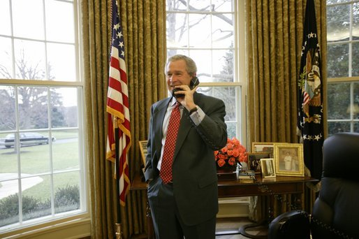 Congratulating NASA on the successful landing of Spirit, the Mars Exploration Rover, President George W. Bush talks with NASA Administrator Sean O'Keefe and the Mission Control Team from the Oval Office Tuesday, Jan. 6, 2004. White House photo by Eric Draper.