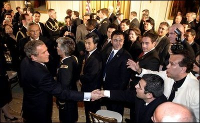 President George W. Bush greets enthusiastic audience members after discussing his immigration policy in the East Room Wednesday, Jan. 7, 2004. White House photo by Paul Morse. White House photo by Paul Morse