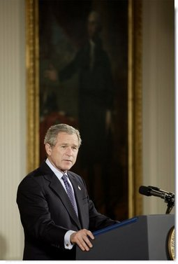 "President George W. Bush discusses his immigration policy in the East Room Wednesday, Jan. 7, 2004. ""We must make our immigration laws more rational, and more humane. And I believe we can do so without jeopardizing the livelihoods of American citizens,"" said President Bush.  White House photo by Paul Morse"