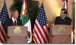 "President George W. Bush and President Vicente Fox of Mexico participate in a press conference Jan. 12, 2004. ""The bonds of friendship and shared values between our two nations are strong,"" said President Bush. ""We have worked together to overcome many mutual challenges, and that work is yielding results.""  White House photo by Paul Morse"