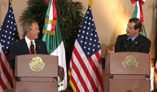 "President George W. Bush and President Vicente Fox of Mexico participate in a press conference Jan. 12, 2004. ""The bonds of friendship and shared values between our two nations are strong,"" said President Bush. ""We have worked together to overcome many mutual challenges, and that work is yielding results."" White House photo by Paul Morse."