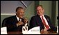 President George W. Bush talks with the Prime Minister Owen Arthur of Barbados during the inaugural ceremony of the Special Summit of the Americas in Monterrey, Mexico, Jan. 12, 2004. White House photo by Paul Morse.