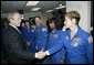 President George W. Bush greets shuttle astronauts from right, Peggy Whitson, Stephanie Wilson, and John Grunsfeld, and Ellen Ochoa at NASA headquarters in Washington, D.C., Wednesday, Jan. 14, 2004. The President committed the United States to a long-term human and robotic program to explore the solar system, starting with a return to the Moon that will ultimately enable future exploration of Mars and other destinations. White House photo by Eric Draper