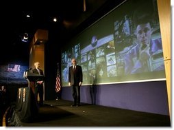 President George W. Bush and NASA Administrator Sean O'Keefe watch as Michael Foale, right, commander of the International Space Station welcomes the President during a live television link from space at NASA headquarters in Washington, D.C., Wednesday, Jan. 14, 2004.  White House photo by Eric Draper