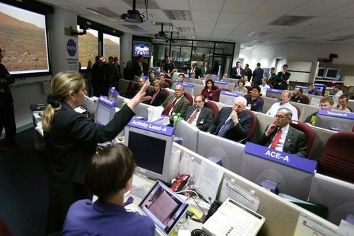 Vice President Dick Cheney listens to a briefing on NASA's Spirit and Opportunity Expeditions to Mars in the Jet Propulsion Laboratory's mission control room in Pasadena, Calif., Jan 14, 2004. JPL developed and now remotely controls the rover Spirit since it landed on the planet Jan. 3, 2004. Sitting next to Vice President Cheney are, from left, Dr. Frederick D. Gregory, NASA Deputy Administrator, Dr. David Baltimore, President of the California Institute of Technology and Dr. Charles Elachi, the Director of the Jet Propulsion Laboratory. White House photo by David Bohrer