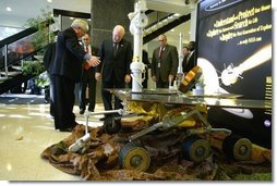 Vice President Dick Cheney looks at a replica of NASA's rover Spirit while touring the Jet Propulsion Laboratory in Pasadena, Calif., Jan. 14, 2004. Spirit, developed and controlled at the laboratory, will explore Mars' Gusev Crater to determine whether the planet ever contained water and if it could sustain life.  White House photo by David Bohrer