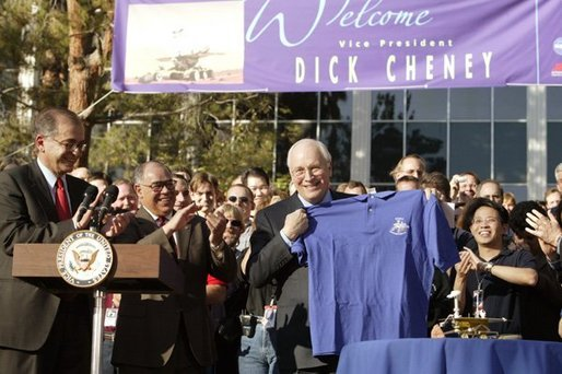 After congratulating NASA staff on the successful landing of the robotic rover Spirit on Mars, Vice President Dick Cheney holds up a shirt bearing the Spirit emblem at the Jet Propulsion Laboratory in Pasedena, Calif., Jan. 14, 2004. White House photo by David Bohrer