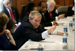 "President George W. Bush holds a roundtable conversation about the positive effects that faith-based initiatives have had on local people at Union Bethel African Methodist Episcopal Church in New Orleans, La., Thursday, Jan. 15, 2004. ""We just had a lot of people from the community, people who have been helped, people who are helping, neighborhood healers here to share their stories,"" said the President about the discussion in his remarks.  White House photo by Eric Draper"