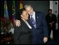 President George W. Bush hugs Coretta Scott King after laying a wreath laying at the grave of Dr. Martin Luther King JR. in Atlanta, Georgia, Thursday, Jan. 15, 2004. White House photo by Eric Draper
