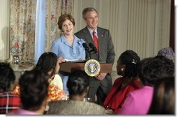President George W. Bush drops-by Mrs. Laura Bush's luncheon for African American clergy spouses at the White House on January 19, 2004.   White House photo by Paul Morse