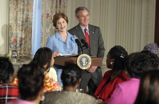 President George W. Bush drops-by Mrs. Laura Bush's luncheon for African American clergy spouses at the White House on January 19, 2004. White House photo by Paul Morse.