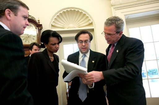 President George W. Bush reviews his State of the Union speech in the Oval Office Tuesday morning, January 20, 2004, with Communications Director Dan Bartlett, at left, Staff Secretary Brett Kavanaugh, National Security Adviser Condoleezza Rice and Mike Gerson, Director of Presidential Speech Writing. White House photo by Eric Draper