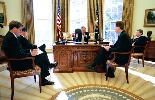 President George W. Bush meets with speechwriters to prepare for his State of the Union speech in the Oval Office Jan. 16, 2004 White House photo by Eric Draper