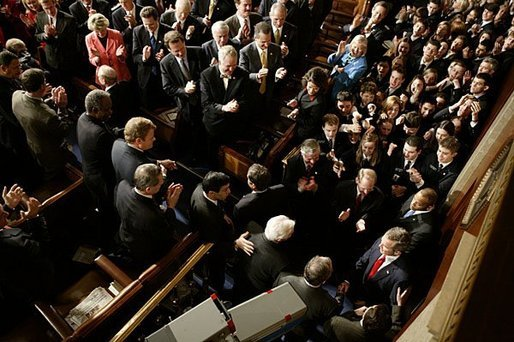 President George W. Bush arrives at the House Chamber of the U.S. Capitol to deliver his State of the Union Address to the nation and a joint session of Congress Tuesday, Jan. 20, 2004. White House photo by Paul Morse